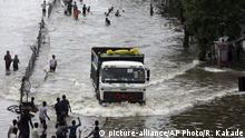 04.08.2019 *** A truck moves through a flooded street following heavy monsoon rains in Mumbai, India, Sunday, Aug.4, 2019. India's monsoon season runs from June to September. (AP Photo/Rajanish Kakade)  