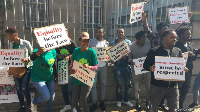 South Africans protesting against the detention and arraignment of migrants in South Africa