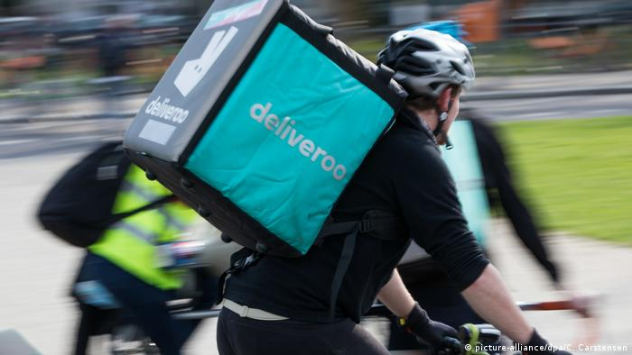 A Deliveroo rider transports an order on a bicycle in Berlin, Germany