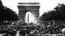 Through the cheering crowds, General Charles de Gaulle leaves the Arc de Triomphe on August 28, 1944 marking the liberation of Paris