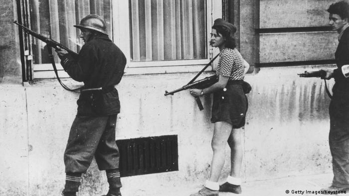 Armed fighters on guard during the liberation of Paris in late August 1944