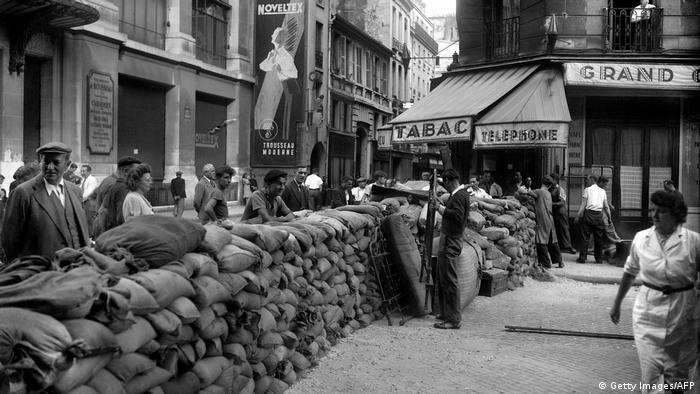 Parisians finish building a barricade at Rue du Renard next to the Paris City Hall (Hotel de Ville) in August 1945 during the Liberation of Paris