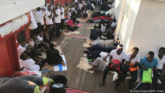 Rescued migrants on the deck of the Ocean Viking