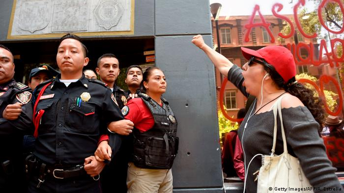 A woman shouts slogans during a protest called by civil organizations against the police
