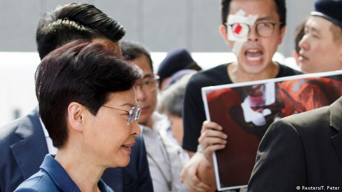 Hong Kong's Chief Executive Carrie Lam meets petitioners outside her office in Hong Kong