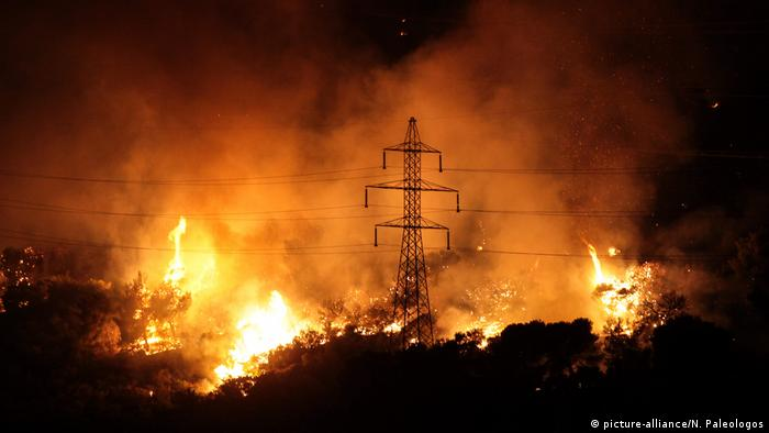 A wildfire rages at night in the Hymettus mountain range outside Athens, Greece