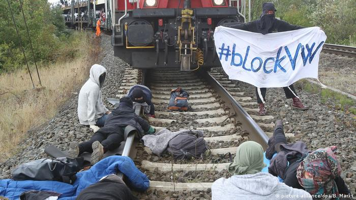 Activists stop a train in Wolfsburg