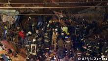 Picture released by Aton Chile showing firefighters working at the site where a house collapsed following a landslide in a hill in Valparaiso, Chile, on August 13, 2019. - At least four people died due to the landslide (Photo by Raul ZAMORA / ATON CHILE / AFP) / - Chile OUT / RESTRICTED TO EDITORIAL USE - MANDATORY CREDIT AFP PHOTO / ATONCHILE / RAUL ZAMORA - NO MARKETING - NO ADVERTISING CAMPAIGNS - DISTRIBUTED AS A SERVICE TO CLIENTS