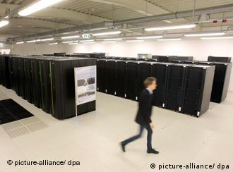 The room where the new computer is housed with a man walking across the field of vision