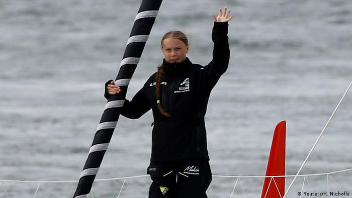 Greta Thunberg waves from the sailboat (Reuters/H. Nicholls)