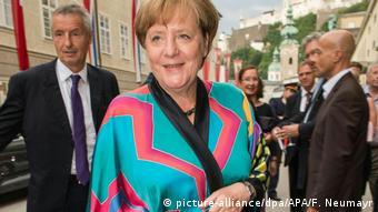 Angela Merkel in a bright blue and red kimono