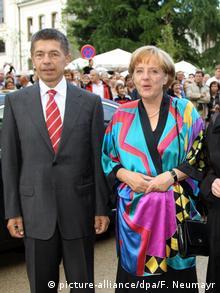 Η Μέρκελ με τον σύζυγό της