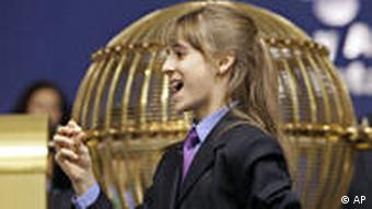 a girl from a school that was once an orphanage sings out the winning 5-digit Christmas lottery prize which has the number 20085 during the Christmas Lottery draw in Madrid Thursday December 22, 2005. The Spanish Christmas lottery known as El Gordo, or the fat one, is even chubbier this year, with total prize money of 2.02 billion (US$2.4 billion). The complex sweepstakes, held Dec. 22 in a three-hour televised ceremony brings Spain to a standstill, with an estimated three of every four Spaniards holding tickets for what is billed as the world's richest lottery. The lottery shuns jackpots in favor of a share-the-wealth system in which thousands of numbers yield at least some degree of Christmas mirth, ranging from the face value of a 20-euro ticket, through a series of more lucrative but lower-level winnings all the way up to the first-prize number, called El Gordo. (AP Photo/Daniel Ochoa de Olza)