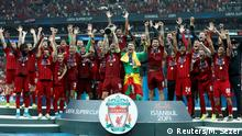 Soccer Football - UEFA Super Cup - Liverpool v Chelsea - Vodafone Arena, Istanbul, Turkey - August 14, 2019 Liverpool's Jordan Henderson lifts the trophy as he celebrates winning the UEFA Super Cup with team mates REUTERS/Murad Sezer