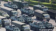 Military vehicles are parked on the grounds of the Shenzhen Bay Sports Center in Shenzhen, China August 15, 2019. REUTERS/Thomas Peter