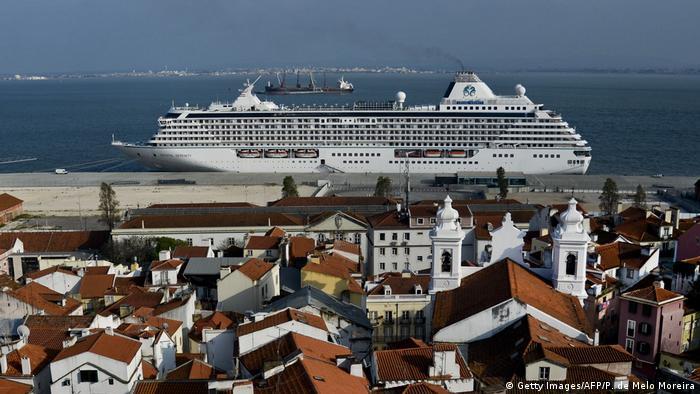 A cruise ship docked in the Alfama neighborhood of Lisbon