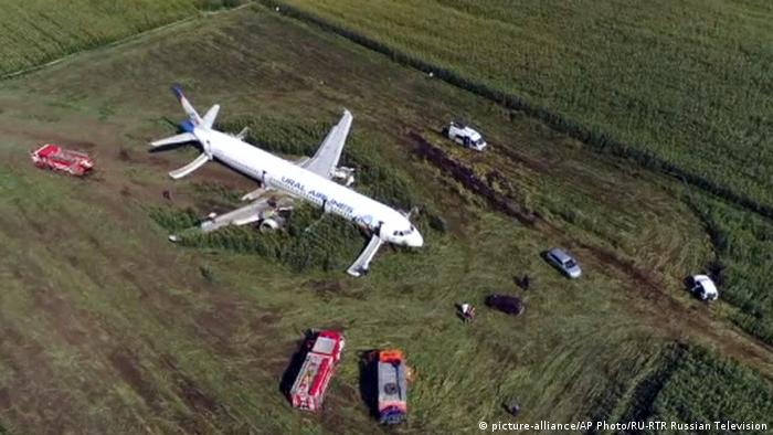Bird's-eye view of a Ural Airlines plane sitting in a field after making an emergency landing