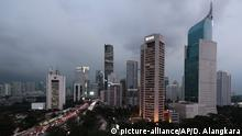 The central business district skyline is seen during the dusk in Jakarta, Indonesia, Monday, April 29, 2019. Indonesia's decades-long discussion about building a new capital has inched forward after President Joko Widodo approved a long-term plan for the government to abandon overcrowded, sinking and polluted Jakarta. (AP Photo/Dita Alangkara) |
