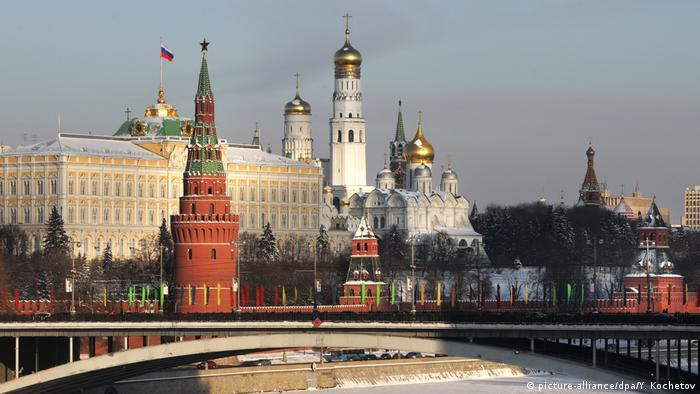 A setting sun lights up the Kremlin in Moscow, Russia