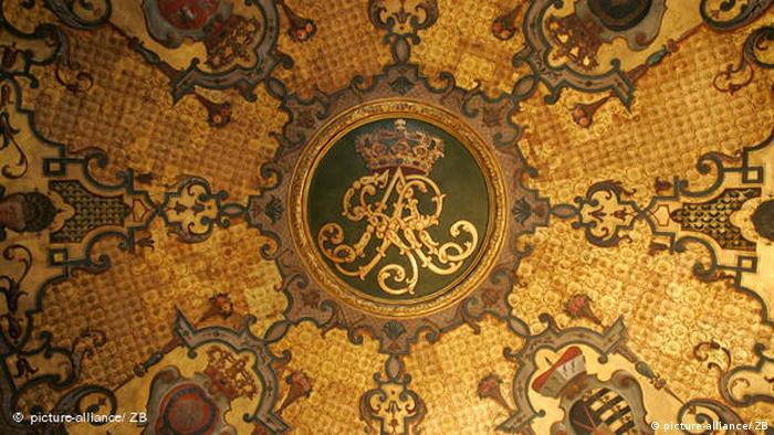 The ornate emblem of the Elector of Saxony on the golden ceiling of a hall in the Green Vault
