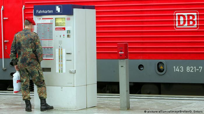 A German soldier prepares to board a train