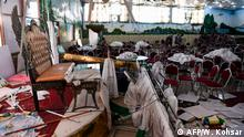 18.08.2019 **** Afghan men investigate in a wedding hall after a deadly bomb blast in Kabul on August 18, 2019. - More than 60 people were killed and scores wounded in an explosion targeting a wedding in the Afghan capital, authorities said on August 18, the deadliest attack in Kabul in recent months. (Photo by Wakil KOHSAR / AFP)