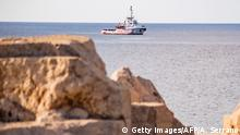 17.08.2019 The Spanish migrant rescue NGO ship Open Arms is seen off the coast of the Italian island of Lampedusa on August 17, 2019. - Twenty-seven unaccompanied minors have been authorised to leave a migrant rescue vessel in limbo off Italy, the Spanish charity operating the ship said. Italian Far-right Interior Minister Matteo Salvini wrote in a letter to Prime Minister Giuseppe Conte that he could authorise the alleged minors to leave the Open Arms ship despite such a move being divergent to my orientation. (Photo by Alessandro SERRANO / AFP) / Italy OUT (Photo credit should read ALESSANDRO SERRANO/AFP/Getty Images)