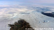 This 2016 photo provided by NASA shows patches of bare land at the Jakobshavn glacier in Greenland. The major Greenland glacier that was one of the fastest shrinking ice and snow masses on Earth is growing again, a new NASA study finds. The Jakobshavn glacier around 2012 was retreating about 1.8 miles (3 kilometers) and thinning nearly 130 feet (almost 40 meters) annually. But the last two years it started growing again at about the same rate, according to a study released on Monday, March 25, 2019, in Nature Geoscience. Study authors and outside scientists think this is temporary. (NASA via AP) |