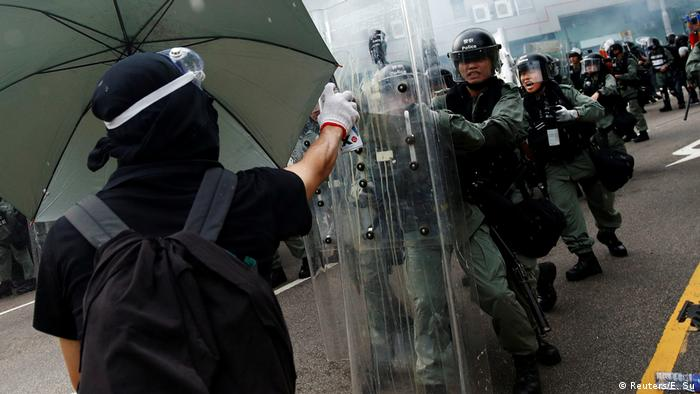 Demonstrators clash with police during a protest against the Yuen Long attack in Hong Kong