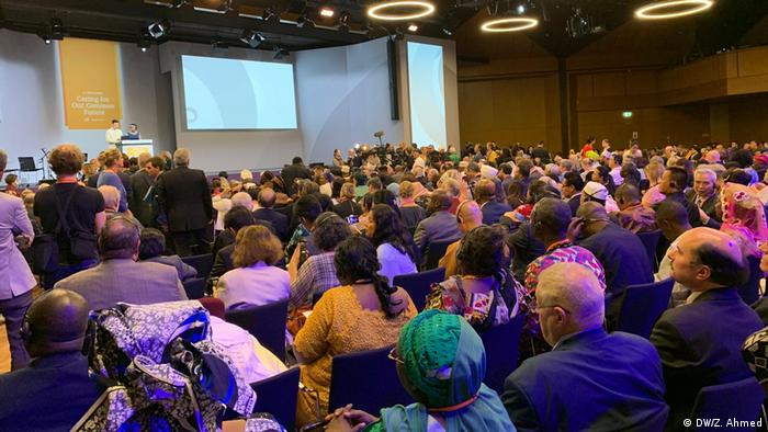 An audience sits and listens to speakers onstage at the Religions for Peace World Assembly (DW/Z. Ahmed)