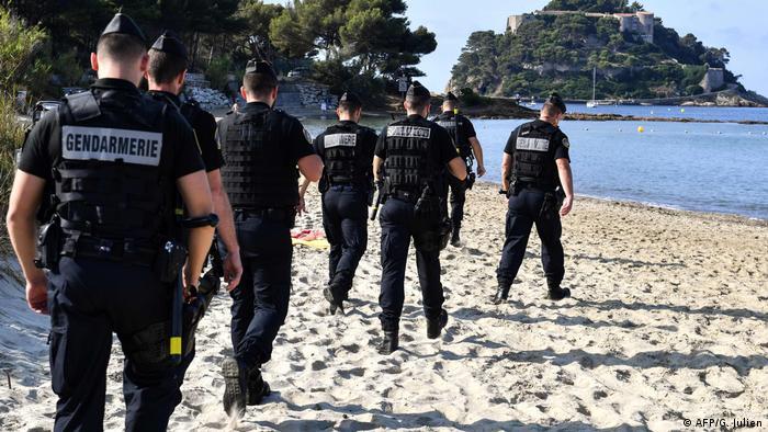 French Gendarmes patrol the beach in Biarritz