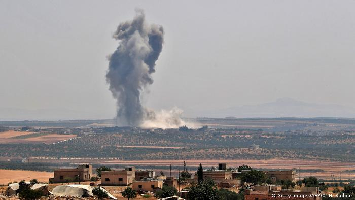 Smoke billows above Khan Sheikhoun in Syria's Idlib province (Getty Images/AFP/O. H. Kadour)