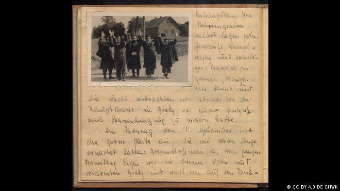 Página com foto e escrita à mão