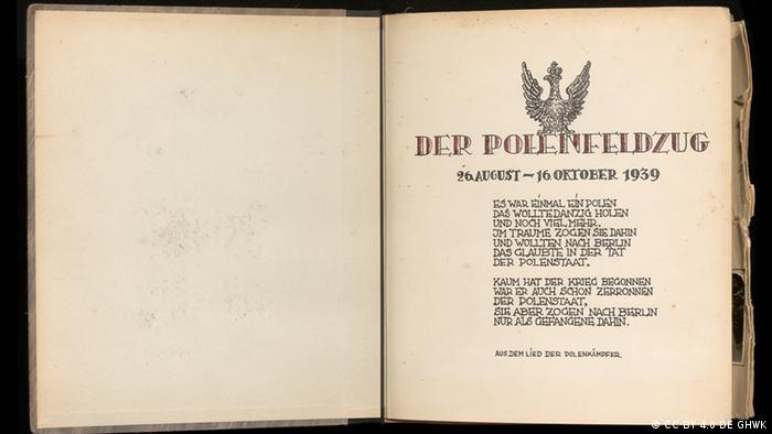 Livro aberto com uma página em branco e outra escrita em alemão