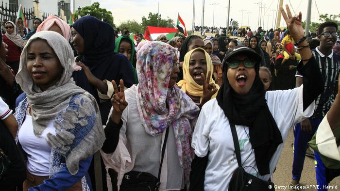 People of Sudan celebrate after a transitional constitution is signed to pave way for civilian rule