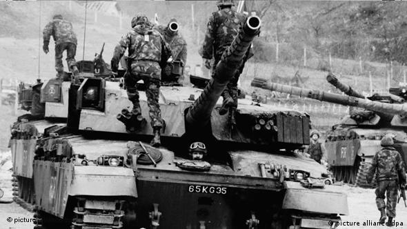 British troops sit waiting on a tank, during the Bosnia conflict.
