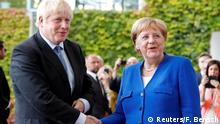 German Chancellor Angela Merkel and Britain's Prime Minister Boris Johnson shake hands ahead of their meeting at the Chancellery in Berlin, Germany August 21, 2019. REUTERS/Fabrizio Bensch