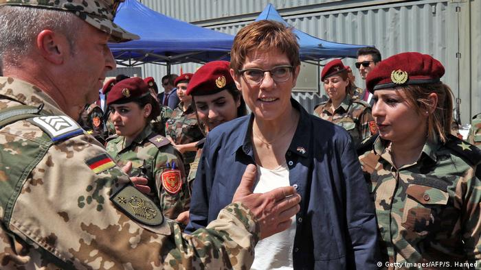 German Defense Minister Annegret Kramp-Karrenbauer as she stands before Iraqi Kurdish women fighters