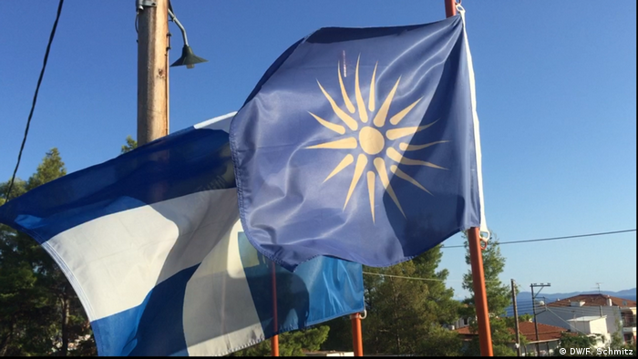 The flags of Greece and the Greek part of Macedonia