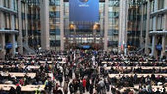 EU staff members gather at the atrium of the European Council headquarters in Brussels, Monday Dec. 14, 2009. Hundreds of European Union staff members have staged a warning strike to push wage demands and have threatened to block EU ministerial meetings later this week. (AP Photo/Yves Logghe)