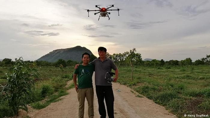 Heng Sopheak and a colleague with an agricultural drone. (Heng Sopheak)