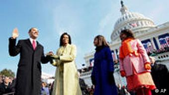 FILE - Barack Obama, left, takes the oath of office from Chief Justice John Roberts, not seen, as his wife Michelle, holds the Lincoln Bible and daughters Sasha, right and Malia, watch at the U.S. Capitol in Washington, Tuesday, Jan. 20, 2009. (AP Photo/Chuck Kennedy, Pool)