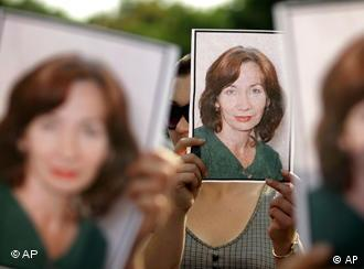 Mourners hold pictures of Estemirova