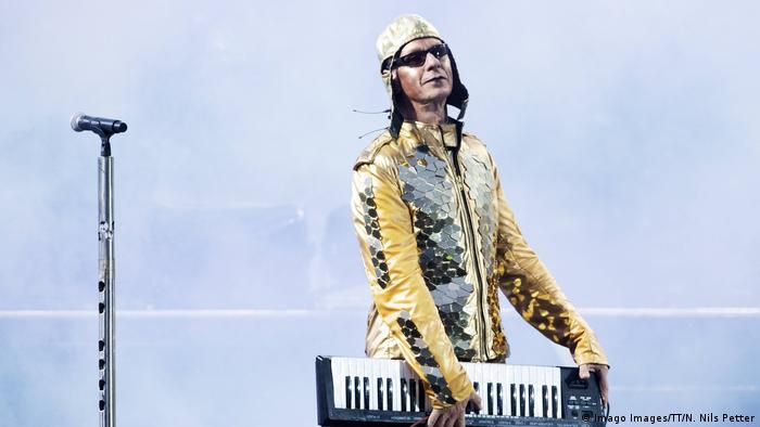 Rammstein's keyboard player Christian Lorenz Flake on stage with a golden aviator's suit