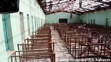 This picture taken on March 5, 2015 shows a view of the burnt-out classrooms of a school in Chibok,in Northeastern Nigeria, from where Boko Haram Islamist fighters seized 276 teenagers on the evening of April 14, 2014. Nigeria's government said that work had begun to rebuild a school in the northeastern town of Chibok from where Boko Haram gunmen kidnapped more than 200 girls last year. Finance minister Ngozi Okonjo-Iweala laid the foundation stone at the Government Secondary School on behalf of President Goodluck Jonathan, a statement from her office said. AFP PHOTO/SUNDAY AGHAEZE / AFP / Sunday Aghaeze (Photo credit should read SUNDAY AGHAEZE/AFP/Getty Images)