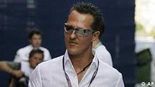 Former F1 world champion Michael Schumacher of Germany arrives at the Valencia street circuit in Valencia, Spain, in this Aug. 21, 2009 file photo. According to media reports from Saturday, Dec. 12, 2009, Mercedes has offered Schumacher a deal for a comeback in 2010 pending the results of a medical exam. (AP Photo/Daniel Leiva)