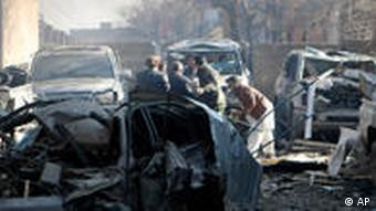 Burnt-out cars after a bomb attack