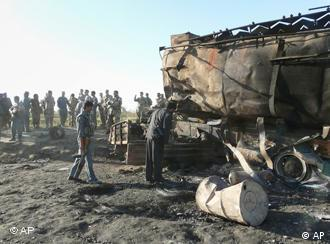 Troops inspect two bombed tankers