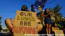 Protesters with banners block the road outside of the Brazilian Embassy during a protest in Nicosia, Cyprus, Friday, Aug. 23, 2019, Some people gathering outside of the Brazilian embassy to call on Brazil's President Jair Bolsonaro to act to protect the Amazon rainforest. The European Union is throwing its weight behind French President Emmanuel Macron's call to put the Amazon fires on the agenda of this weekend's G-7 summit of world leaders in France. (AP Photo/Petros Karadjias) |