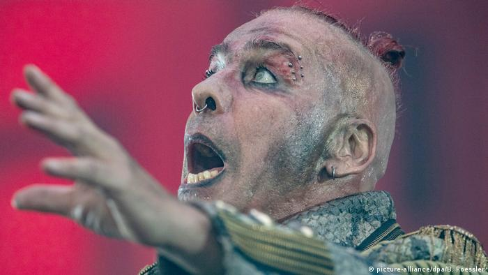 Till Lindemann, face made up and mouth wide open